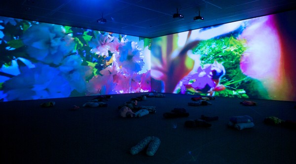 Pipilotti Rist: Mercy Garden Retour Skin, 2014, six-channel HD video installation, sound, carpet, pillows, installation view of the 19th Biennale of Sydney at the Museum of Contemporary Art Australia, courtesy the artist, photograph by Ben Symons. All rights reserved.