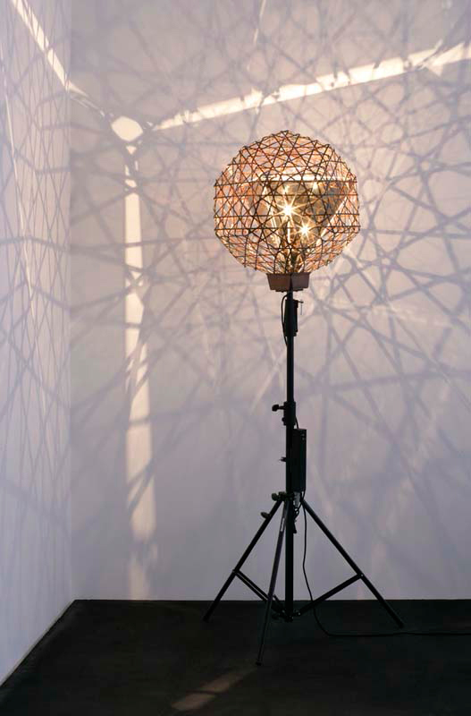 OLAFUR ELIASSON, Fivefold dodecahedron lamp, 2006. Copper, semitransparent mirror, steel, bulb, cable, tripod. Courtesy the artist and Tanya Bonakdar Gallery, New York. All rights reserved.