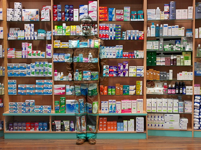 Liu Bolin, Hide in Paris n°12 - Pharmacy, 2013, 135 x 180 cm © Liu Bolin / Courtesy Galerie Paris-Beijing. Used here by kind permission. All rights reserved.