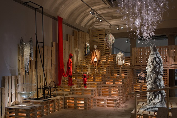 Sustainability gallery, Issey Miyake's and Dai Fujiwara's red ensemble together with H&M's dress with beads of recycled glass dominating the room next to pieces by, among others, Hussein Chalayan and Miguel Mesa Posada. Photo: Mattias Lindbäck. Image courtesy of Liljevalchs. Used here by kind permission. All rights reserved.
