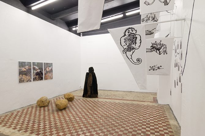 City Agents exhibition, installation view. Right: Uku Sepsivart - Rise of the Beaversculptor, 2016, installation. Left: Rena Rädle & Vladan Jeremić - Real Struggle, Fake Estates, 2016, textile flags and acrylic. Photo: Johannes Säre/EKKM. Used here by kind permission from curator Jussi Koitela. All rights reserved.