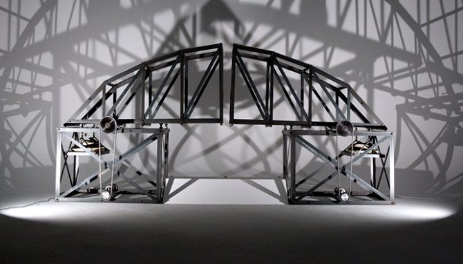 Naomi Dodds, BRIDGE, 2016. Carbon Steel, Aluminum, DC Motors, Hardened Steel Gear Sprockets, Roller Chain, Pillow Blocks, Shore Rock, Limit Switches, Parallax PING Ultrasonic Sensors, Custom-­Built Circuit, Arduino Uno, Sabertooth 2X25 V2, U1 12V 230A Battery. 50'' x 30'' x 78'' (when closed) 102'' (when open). Image courtesy the artist. All rights reserved.