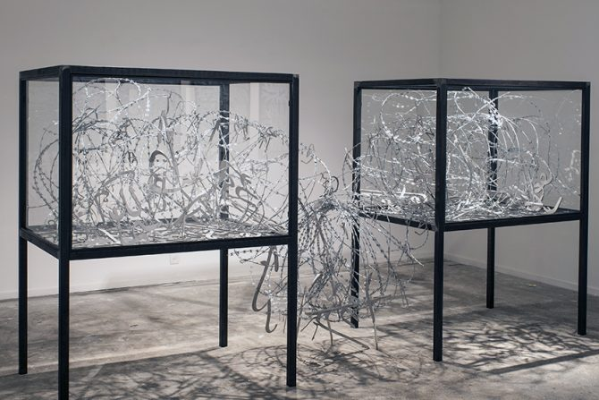 mounir fatmi, Dead Language, 2016. Steel, windows, barbed wire and calligraphies. Each element: 125 x 90 x 165 cm. Courtesy of the artist and Keitelman Gallery, Brussels. All rights reserved.